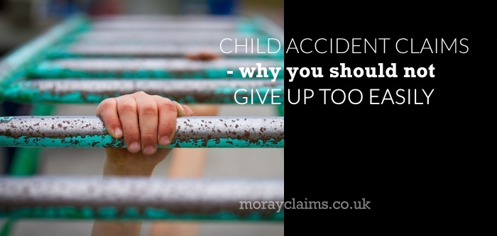 Child's hand on monkey bars