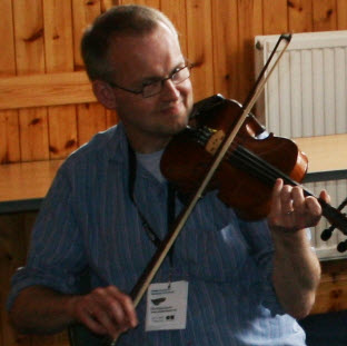 Peter Brash playing his fiddle at Fiddle Frenzy in Shetland
