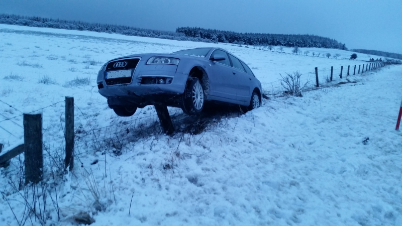 Car impaled on a Moray fencepost in the snow