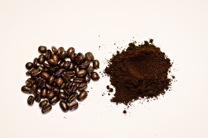 Coffee beans and ground coffee in separate piles.