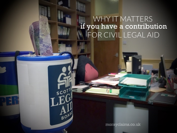 Collecting Tin with Scottish Legal Aid Board Logo and £20 sticking out of the top