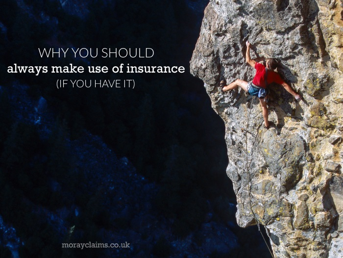 Rock climber at crux of climb