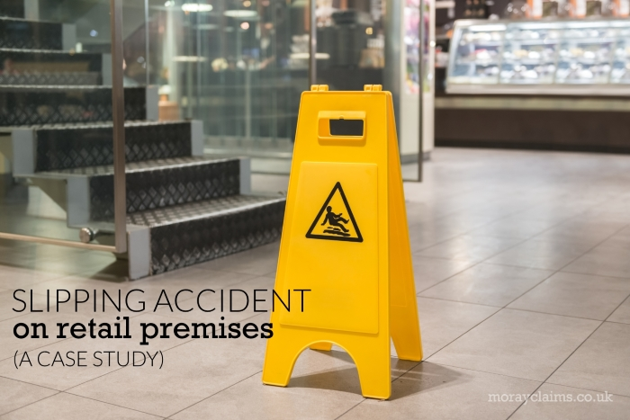 Yellow Wet Floor sign on tiled floor in retail premises